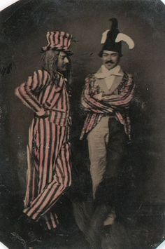 ca. 1860-1900, [tintype portrait of two gentlemen in pink, hand-tinted, striped costume]  via Cowan's Auctions