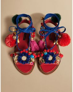 Instantly liven up any outfit with Dolce & Gabbana's lambskin leather lace-up sandals. With multicolored pom-poms, mirror work and crystal detailing, this pair tie at the ankle and are a perfect match to minimal outfits. The satin insole and a customized leather sole add a final luxe touch.