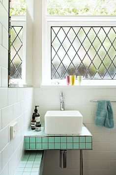 I love the leaded glass window and turquoise/white combination! dream house: the bathroom / sfgirlbybay