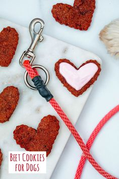 Heart-shaped beet cookies for dogs on marble tray with leash and dog paw in background and recipe title at bottom of image Valentine Status, Valentines Day Hearts, Love Beets, Fresh Beets, Natural Food Coloring, Pink Food Coloring, Dog Cookies, No Bake Cookies, Sour Cream Icing