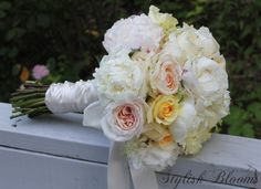 Soft pink, yellow, cream and white bouquet with peonies and garden roses