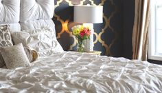 The most luxurious bedroom featuring white textured bedding. Designed by Emma from The Sweetest Thing blog