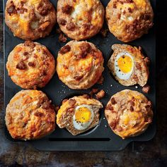 Soft-Yolk Muffins with Sausage and Cheese | Dazzle family and friends with these meaty muffins that break open to reveal medium-boiled eggs with creamy yolks in the middle. You need two sizes of egg here--the mediums fit in the muffin tins, while the larges go in the batter.