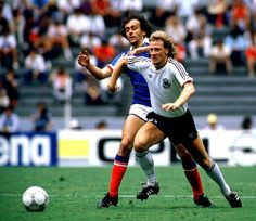 France 0 Germany 2 in 1986 in Guadalajara. Michel Platini and Wolfgang Rolff chase the ball in the World Cup Semi Final.