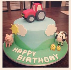 Farm Barnyard theme cake for 2nd birthday. Tractor cake topper, gumpaste animals, pig, cow and chickens