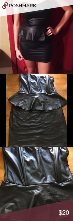 Black Cocktail Dress Lightweight pleather like strapless dress doesn't have a size in it but my niece is a small and it tight on her(photo). It is one piece but looks like skirt and peplum top. Lots of stretch. Zip back. (C) Dresses Strapless