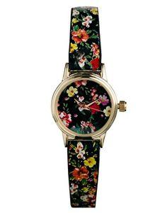 Imagen 1 de Reloj con diseño floral sobre fondo negro Helen de River Island