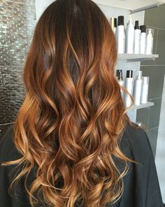Summer coppery chestnut sombre using a wet dry brush glow method. Call for inquires Austin Hodges at Duncan Brothers salon Edmond, OK.