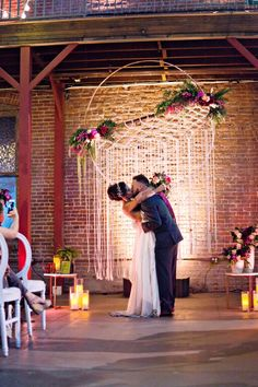 Large dream catcher backdrop for a boho wedding