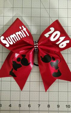 This bow is based on 3 inch ribbon with a shimmer red fabric bonded on top creating a stiff bow. The writing on this bow is glitter. Please message