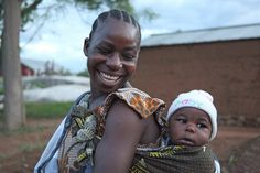 This Tanzanian mum is now smiling at her future. Photo Tearfund/Louise Thomas http://www.tearfund.org/
