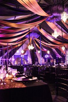 For a 2012 holiday party for CyberCoders in Newport Beach, California, 10 crystal chandeliers decorated a heavily draped ceiling in a space done in black, gold, and purple.