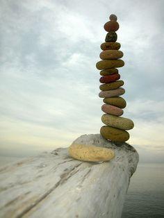 ...multicolored..... by rebranca46, via Flickr. Beach stone balance.
