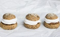 A cardamom-spiced wheat bun which has its top cut off, and is then filled with a mix of coconut milk and almond paste, and topped with coconut whipped cream.