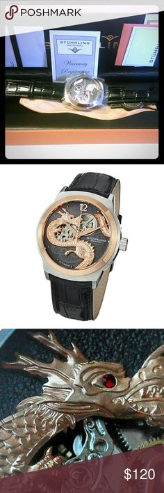 New Men's Stuhrling Original Dragon Watch DESCRIPTION Stainless Steel Case on Black Alligator Embossed Genuine Leather Strap, Black Dial with Applied Rose Tone Snake Design, Rose Tone Bezel, Rose Tone Accents and One Crystal Red Stone TECHNICAL DATA Alpha-Style Hands Applied Arabic - 12, Applied Square Indexes - 3,4,5,6,7,8,9,10, and 11 Polished Bezel 3H-9H: 42mm; 6H-12H: 42mm Screw Down Exhibition Case Back Krysterna Crystals (Front & Back) Push/Pull Fluted Crown with Stuhrling S Logo 5 ATM…