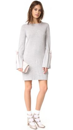 Contrast bows bring girly flair to this delicate wool Club Monaco sweater dress. Crew neckline. Long sleeves. Unlined.