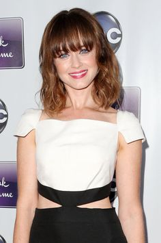 Alexis Bledel's blunt bangs, tousled waves, and bright pink lips.