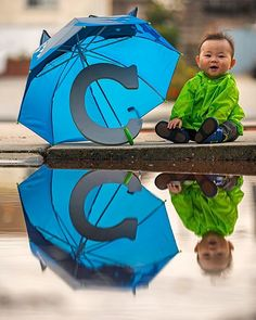 January Rain ________________________________  8 months! 2015 flew by. Heres the first monthly shot of Cole for 2016. Wanted a rain type theme for January so we decked him out in some new rain gear and used a puddle to catch his reflection. Took this at my parents house where we used to jump in rain puddles here as kids. Looking forward to watching him be able to do that once he is older. WB on the cooler side to match the theme. Nikon D750 Nikkor 70-200 f/2.8 1/800 sec ISO-500…