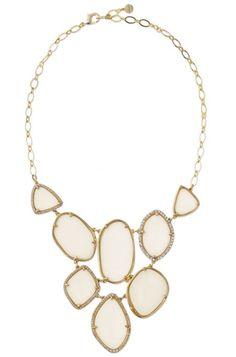 Fiona Bib Necklace by Stella & Dot. Photo of ivory expoxy modern necklace set & surrounded by glass stone.