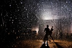 """""""Rain-Room-0845"""" by barbican_centre, via Flickr. #barbican_centre #rain #room #light #shadow #silhouettes #dancers #dancing #droplets #white #gold #black"""