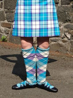 Photo of Iona Mckeown at the Commonwealth #HighlandDancing Championship in Stirling 2013. She's wearing #BonnieTartan's Bonnie Aqua #Velvet & Bonnie Aqua #Tartan #kilt with matching alternating marl #hose made by Bonnie Tartan.