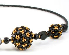 Cindy Holsclaw, black and gold beaded necklace