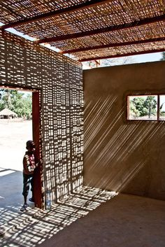 Interesting play of light from the woven thatched roof at the Youth Center in Niafourang, Senegal by Project Niafourang