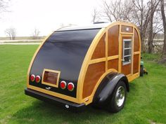 """The """"Woodybago"""" needs a new owner… For Sale is my Custom built Mahogany and Ash, 2007 Teardrop trailer. Approximate size is 5′ X 9′ with a double size bed inside. Cust…"""