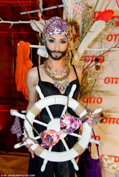 Clasping a ship's wheel, Conchita Wurst pulls off a maritime look...