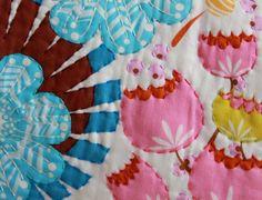 Big fan of stitching along with a fabric pattern.