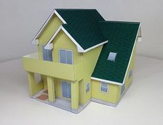 Japanese Yellow House Paper Model - by Tokaworks - == -  This is the seventh building paper model of the architectural series by Japanese website Tokaworks. Visit the page to download this and the other models of this series. Models is 1/100 and 1/150 scales.