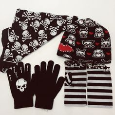 Soft Core Skulls Accessories Bundle Cute bundle with skeletal animals with hearts beanie, black and white striped hobo gloves with studs (small with slight smudging on black in Palms), a black bandana with cute skulls and a pair of stretchy gloves with... You guessed it... Skulls. All in excellent condition other than hobo gloves which are in good condition. Accessories