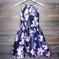 - fully lined - 100% polyester - open back, now comes with adjustable straps, and a hidden back zip closure. - hand wash cold - imported - color: purple (print; floral print), navy (print; pink/purple