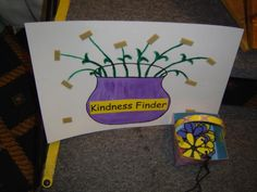 Kindness Finder student puts up a flower each time an act of kindness or helpfulness is noticed.