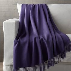 """Indulge in the warmth and luxury of premium alpaca wool, known for being softer and warmer than the finest lambswool. The fiber also absorbs color beautifully and is less likely to pill than wool. Finished with finely spun 4½"""" fringe."""
