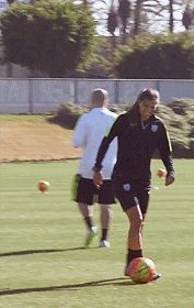 """Tobin Heath nutmegging people before training sessions. """