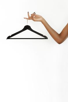 Polished and professional styled stock photography for your business' sales graphics featuring a monochromatic black and white color palette. Mockup image of woman holding black hanger on white background. Instagram Background, Instagram Frame, Instagram Logo, Hanger Logo, White Background Photography, Vide Dressing, Fashion Wall Art, Clothing Photography, Rose Illustration