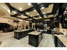 This is an INSANELY large kitchen! I love how this is such a big kitchen. Looks like the size of my whole entire house. If I am going to do this I would take out the side bar. Luxury Kitchens, Home Kitchens, Tuscan Kitchens, Dream Kitchens, Mansion Kitchen, Grande Armoire, Big Kitchen, Kitchen Size, Kitchen Black