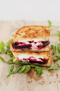 BEET, ARUGULA & GOAT CHEESE GRILLED CHEESE:      1-2 Roasted Beets     Olive Oil     Arugula     Goat Cheese     Butter     French Bread     1/2 ounce sherry (optional)     Salt