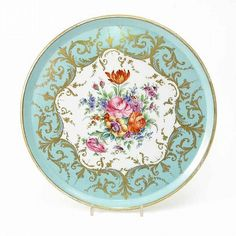 <b>A 19th century French porcelain tray,</b></i> circular, painted with flowers within a gilded bleu celeste border, painted mark, <i>13in.</b></i><br><b>Estimate £50-70</b>