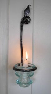 Forge Ahead | Candle Sconce that is hand-forged from iron features leaf motif and glass holder
