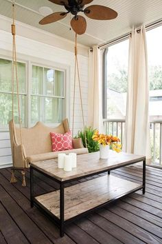 front porch with swing and long curtains