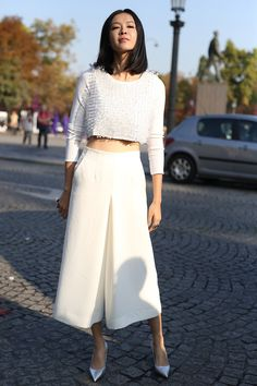 White culottes with a white crop top and pointy pumps at Paris Fashion Week.