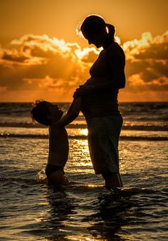 with my wife and son. tonight at the beach behind our house 27/7/12  1 month to go, then a few baby photos may appear ;o)