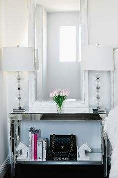 matching lamps flanking a BIG mirror