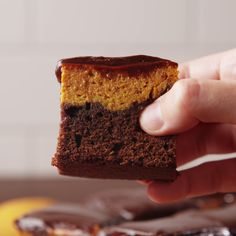 This Pumpkin Pie Brownies are a perfect dessert and snack for Fall. They are layers of brownie cake mix of pumpkin puree mix baked until an inserted toothpick at the center comes out clean. This cool brownie cake is then covered with sweet and tangy Köstliche Desserts, Delicious Desserts, Dessert Recipes, Yummy Food, Bar Recipes, Pumpkin Dessert, Pumpkin Cheesecake, Brownie Recipes, Cookie Recipes