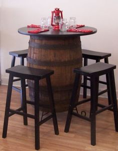 """Also included, is a black wrought iron stand and four black wooden 29"""" saddle bar stools. 