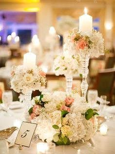 Candles and flowers for table number idea www.MadamPaloozaEmporium.com www.facebook.com/MadamPalooza
