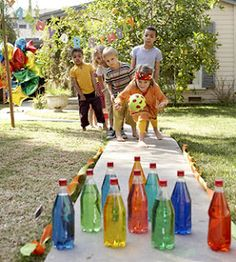 Make a backyard bowling alley. Add a few drops of food coloring to ten clear plastic bottles of water. Stand them up on flat ground, use party streamers as lane margins, and score a strike for saving cash