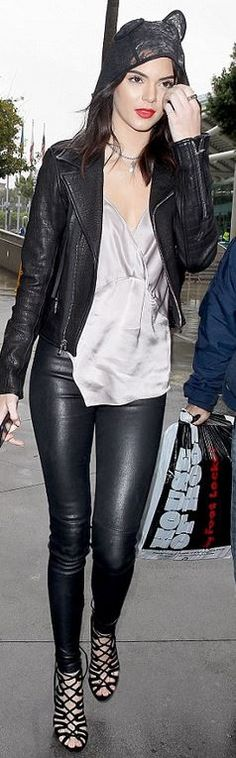 Who made  Kendall Jenner's lace ear hood, gray satin top, leather pants, and suede lace sandals?